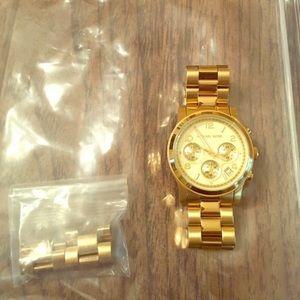 COPY - Gold Michael Kors watch.